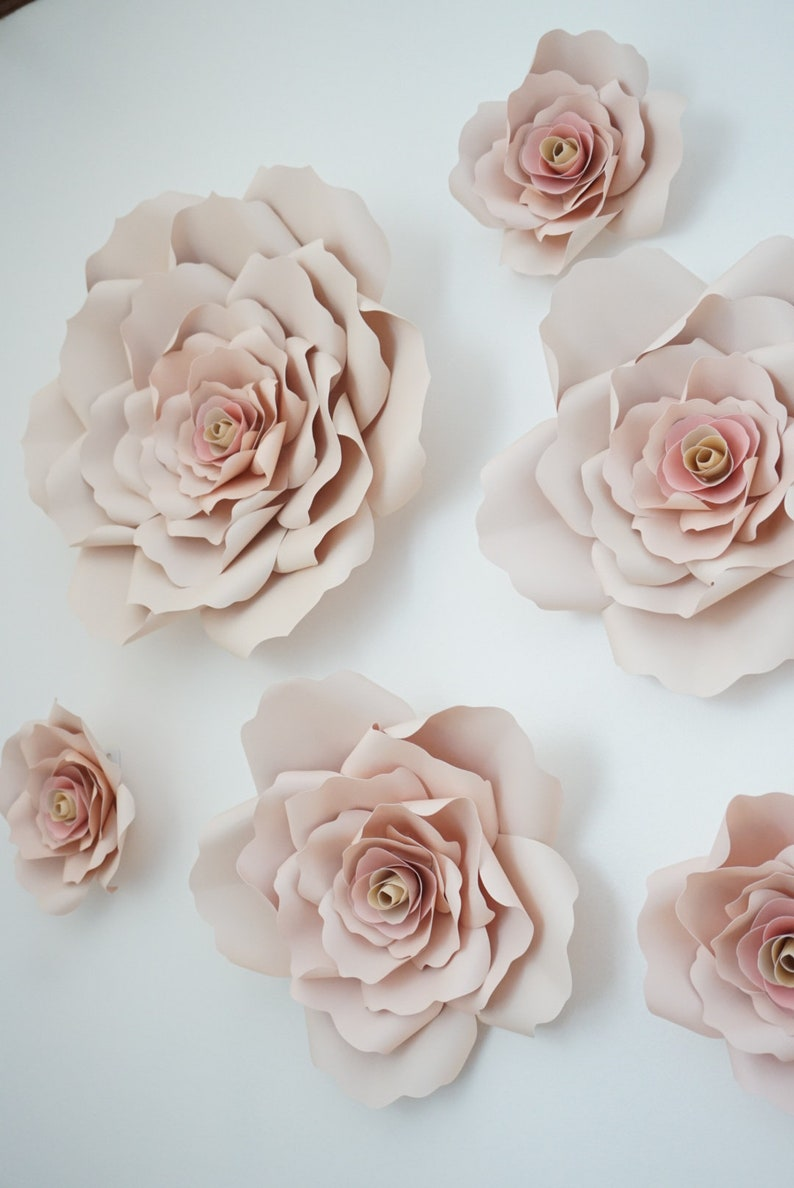 Blush paper roses. Pink & Gold Bridal Shower Decor, DIY + Gift Ideas...certainly lovely indeed. Decorating ideas for bridal showers and gift guide as well as DIY ideas for romantic paper flowers!
