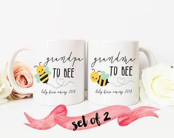 Pregnancy Reveal / Grandma an Grandpa to be with custom name and date set of TWO mugs / Ceramic / Dishwasher Safe