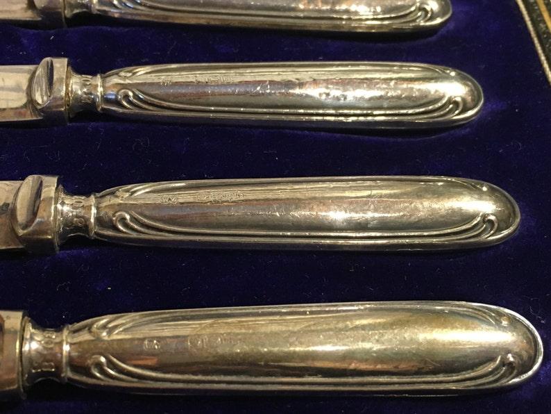 Six silver handled butter knives sheffield assay 1918
