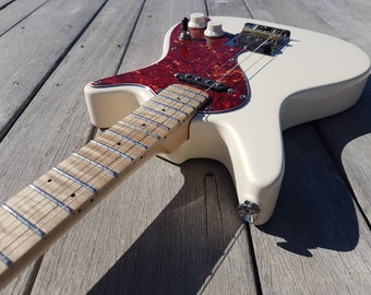 """Nguni tenor guitar. 22.8"""" scale length. Custom build for Riley, Cherry Red with Maple Neck and Curly Maple Fretboard.. Gig bag included."""