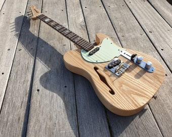 Deluxe thinline pixelator Custom Built to your spec. Tenor or baritone scale length. Please contact us to discuss your build and pricing.