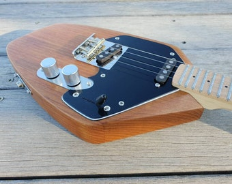 """Wisp electric ukulele in reclaimed teak. Baritone scale length 19"""". Dual pickup with 3 way selector. Maple fretboard with vintage tint."""
