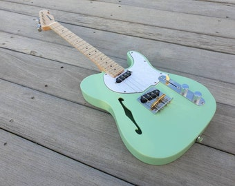 Thinline baritone Pixelator Ukulele in seafoam green with maple neck in the main picture. Custom made to order according to your specs.