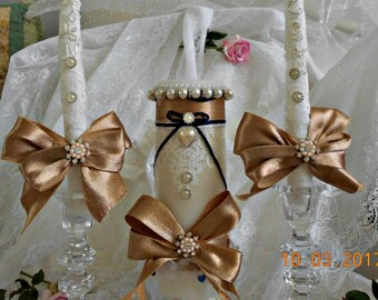 UNITED AS ONE  with this beautiful unity wedding candle set held by 3 lead crystal holders . Rose Gold ribbon ,white  lace , and pearls ect.