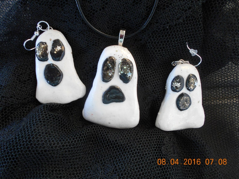 hand sculpted,baked,glazed and sealed .Black and white Ghost pendant and earring set in time for Halloween at the office or school stars.