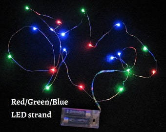 6-foot Red/Green/Blue LED strand with silver wire and 20 LEDs.  Uses 2-AA batteries.  Batteries not included.