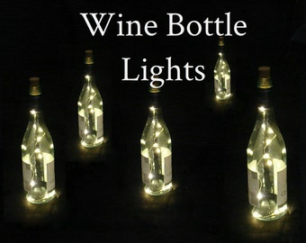 Pack of 5 Wine Bottle Light Strands with 10 LEDs per strand.  Battery powered, on/off switch, batteries can be replaced. Warm White LEDs.