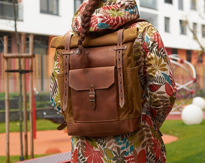 Roll top backpack in cumin timber colour.
