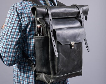 "Large leather roll top backpack in dark grey. Travel Rucksack for 16"" laptop."