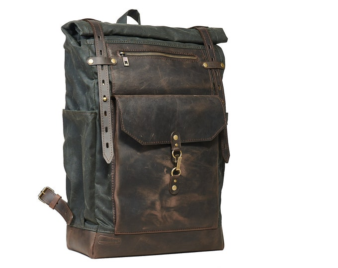 Dark green wax canvas roll-top rucksack. Laptop backpack.