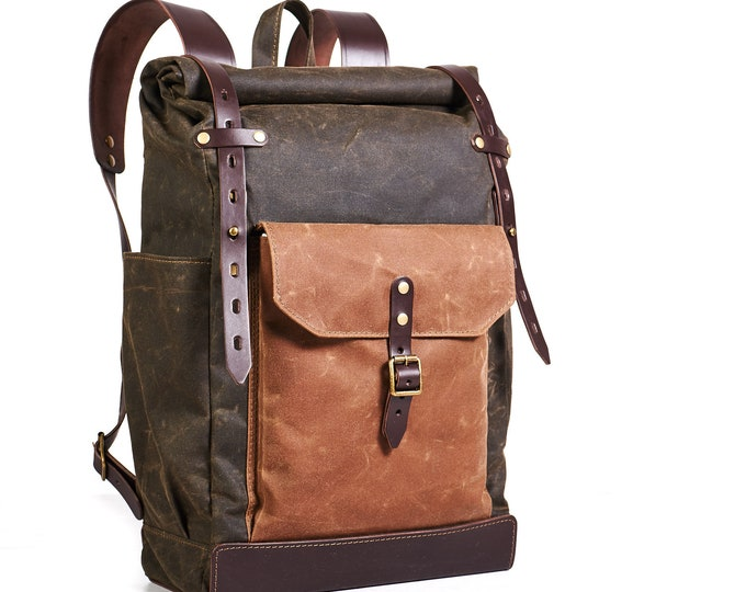 Waxed canvas roll-top backpack. Hipster backpack in dark olive color.