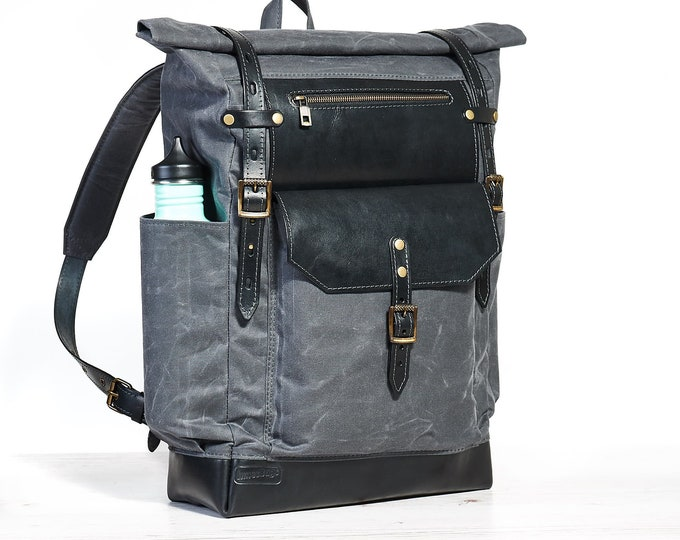 Roll top waxed canvas and leather backpack for 15 inch laptop.