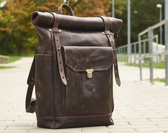 "Mens leather backpack.  Roll top rucksack for 15"" laptop."