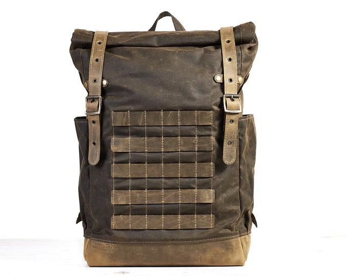 Dark olive waxed canvas leather backpack with molle grid. Travel backpack.