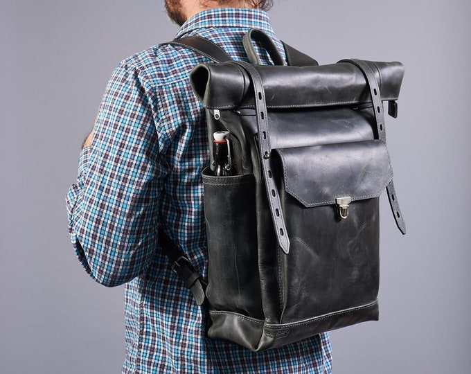 "Large roll top leather backpack. Travel Rucksack for 15"" laptop."