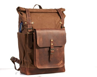 Tan brown waxed canvas backpack with molle grid. Leather crossbody bag.