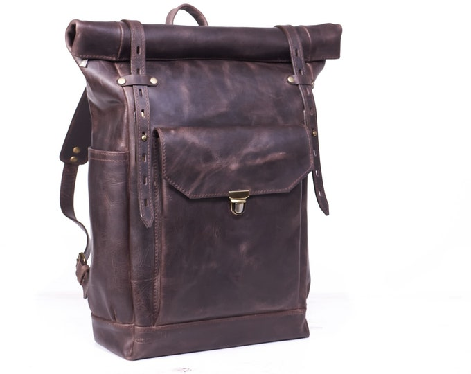 "Roll top leather backpack in dark brown colour.  Rucksack for 15"" laptop."