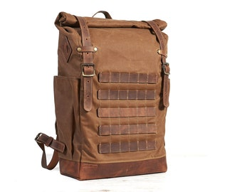Tan brown waxed canvas leather backpack with molle grid. Travel backpack.