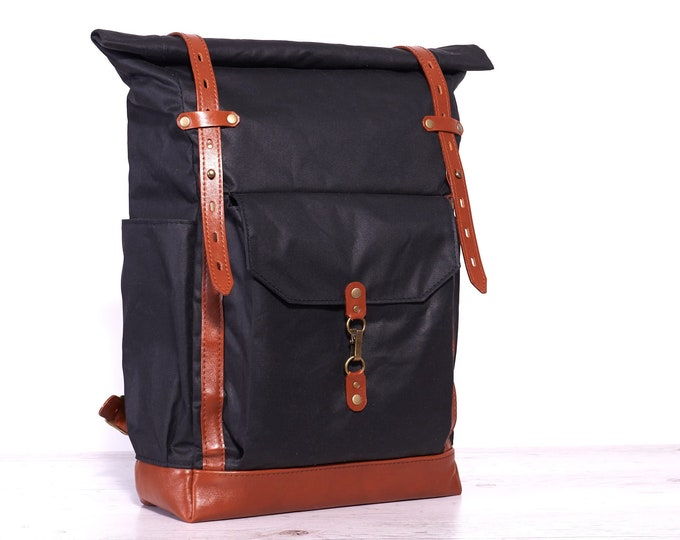 Black wax canvas bag. Hipster roll-top backpack.