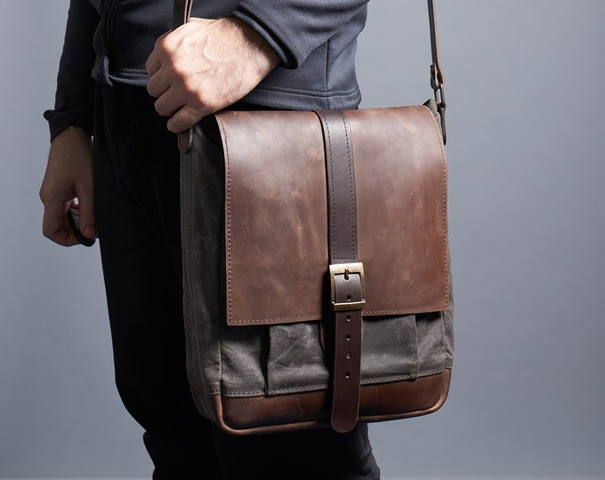 Waxed canvas and leather messenger bag in dark chocolate brown colour.