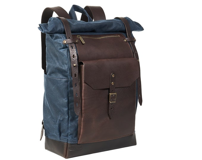 Roll top waxed canvas leather backpack in navy blue and brown.