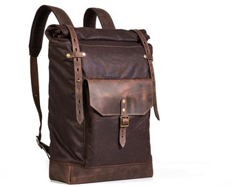 Dark brown waxed canvas rucksack. Leather canvas backpack.
