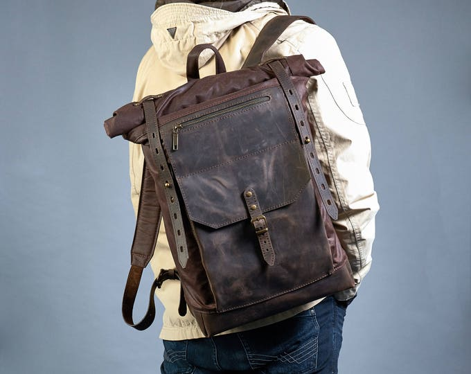 Roll top canvas leather backpack. Dark brown waxed canvas, crazy horse leather.
