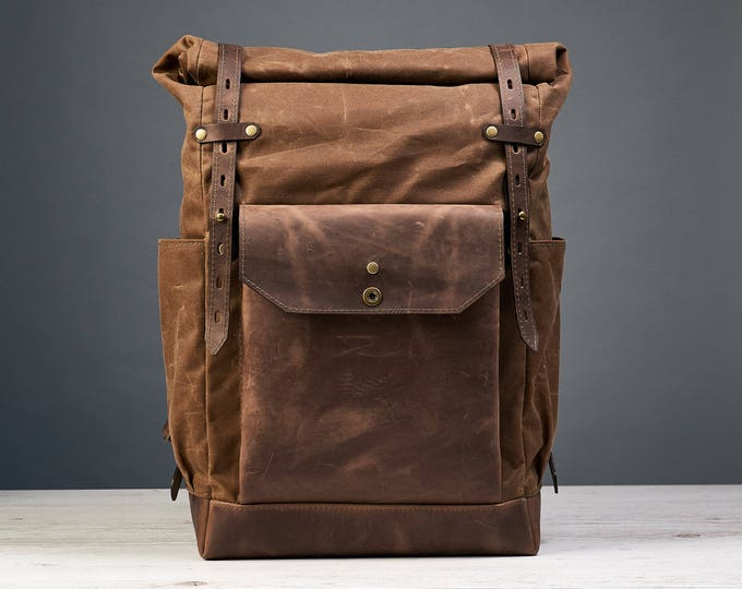 Brown waxed canvas leather backpack. Travel bag.