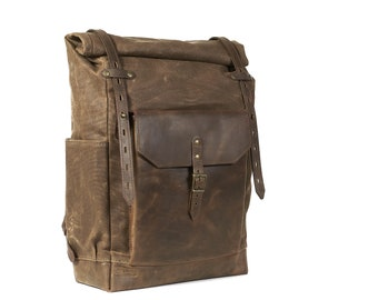 """Waxed canvas rucksack with full-leather pocket 