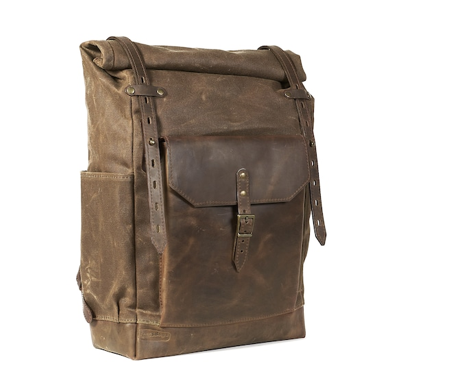 "Waxed canvas rucksack with full-leather pocket | Rolltop closure, field tan heavy canvas, brown ""crazy horse"" waxed leather."