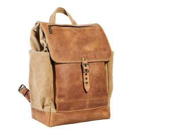 Vintage style waxed canvas backpack with leather flap closure. Small travel rucksack.