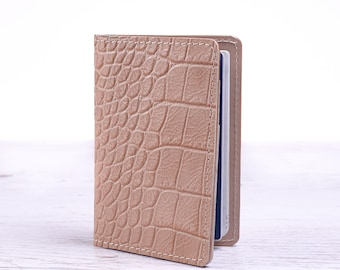 Beige leather passport cover. Travel pass holder.