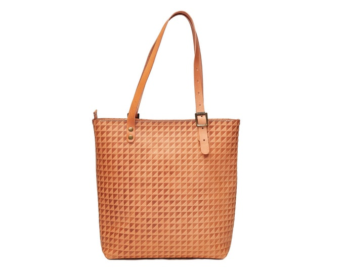 Tan leather tote bag.