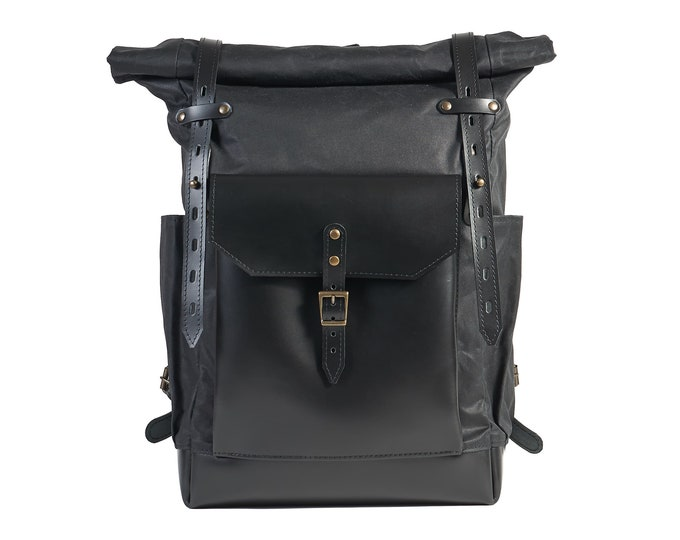 Black waxed canvas backpack with full leather pocket.