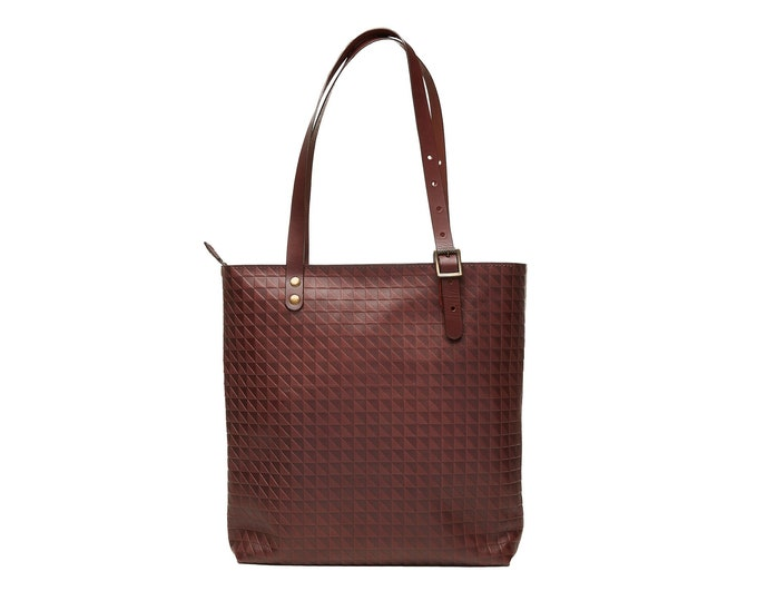 Brown leather tote bag.