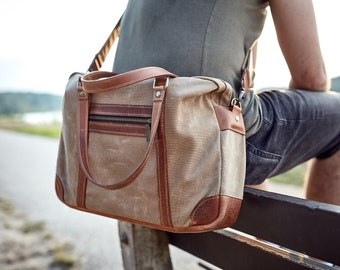 Waxed canvas messenger bag with leather handles, removable shoulder strap