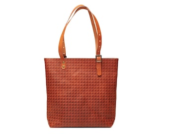 Women's embossed leather tote bag