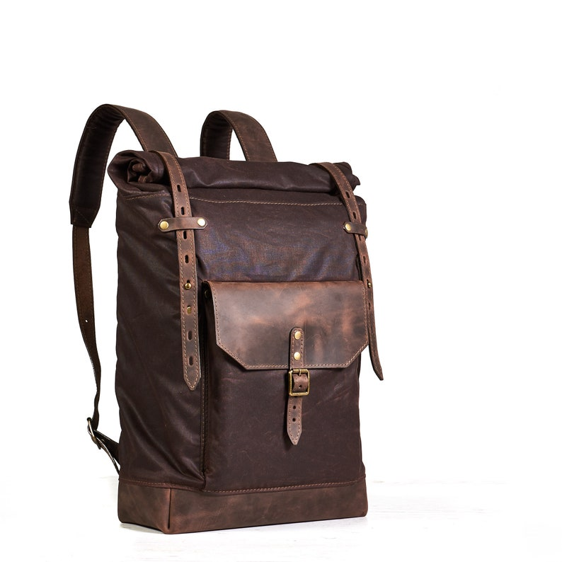 Roll top canvas leather backpack for laptop in dark brown.  b4df52bf0dd2d