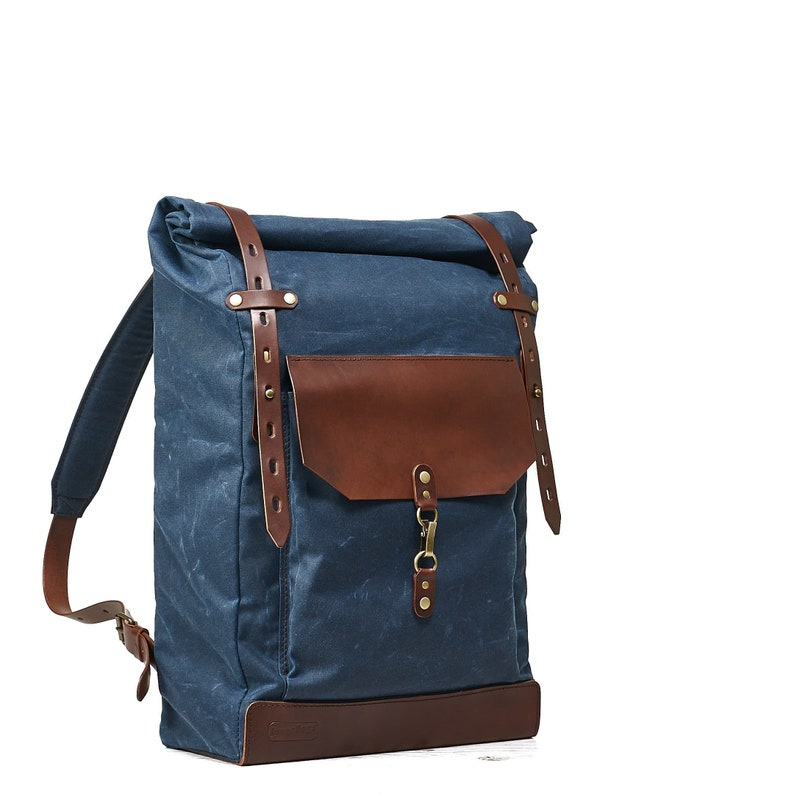 35c8d7c943 Navy blue waxed canvas backpack. Roll top canvas leather