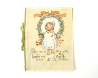 VINTAGE CHRISTMAS CARD - Rare and collectable / sweet little girl and dolls design