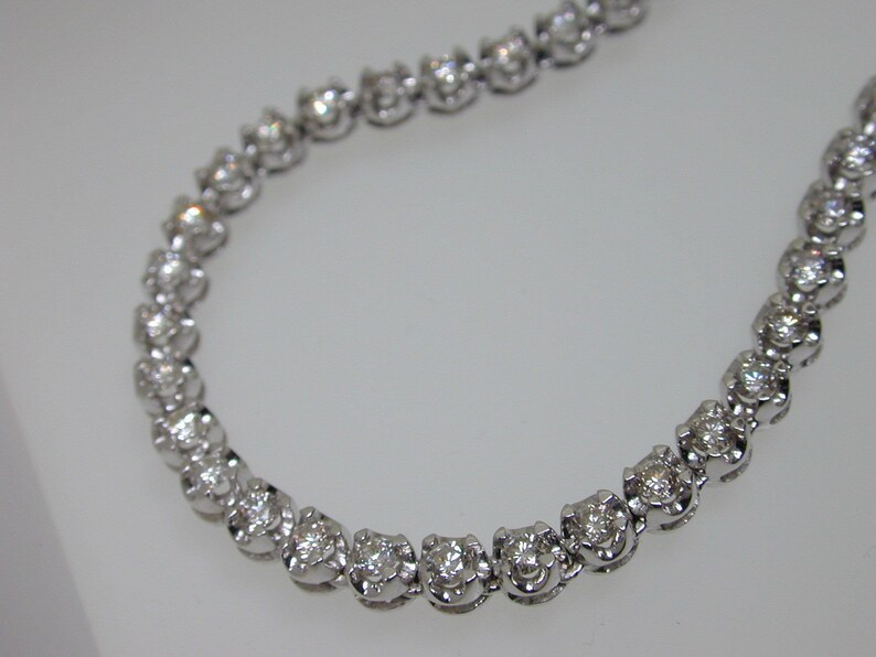 fef334ed41697 Diamond graduated tennis necklace 18 carat white gold 5.00 carats 17
