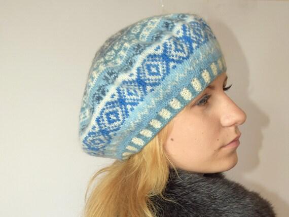 Hand knit wool hat in green Scandinavian design.