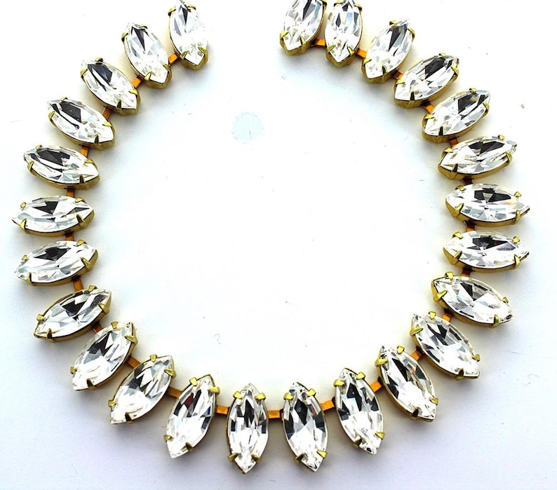 15x7 navette brass chain set with best quality crystal stones.