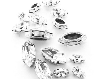 Crystal Navettes in sew on settings silver and gold.  Price is for 10 pieces.