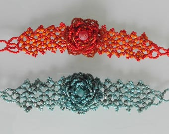 Handmade bracelets with glass beads. Broad band with flower.