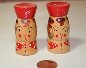 Tiny wooden vintage Japan made salt and pepper shaker set 2 inch tall hand painted girl with red hat