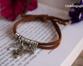 Alice in Wonderland bracelet with brown ribbon