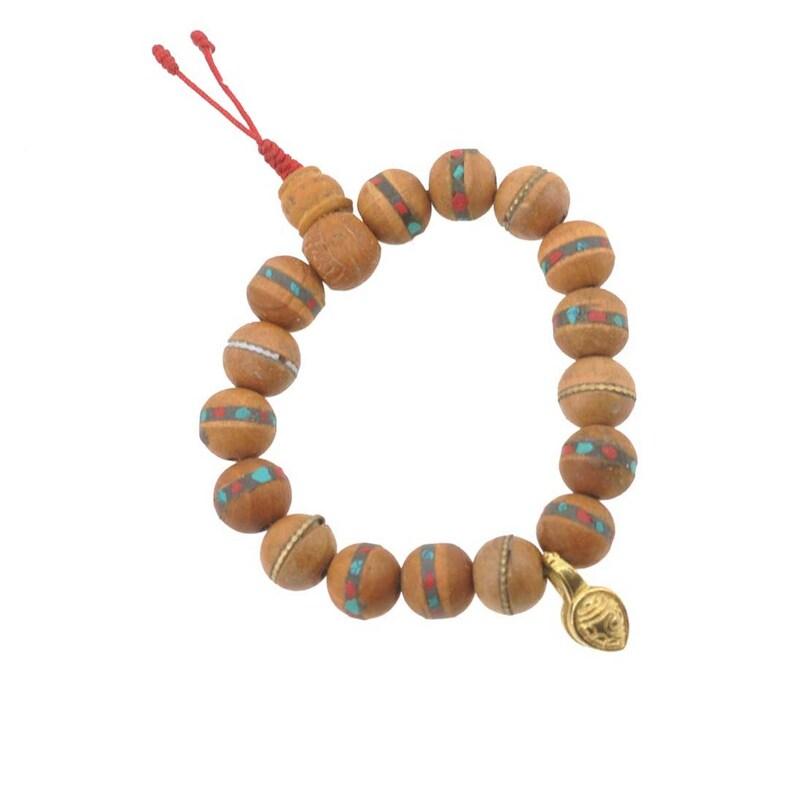 d5bea14ecc27 Pulsera de Rosario la Mala budista madera medicina granos
