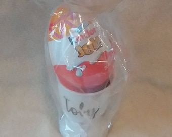 Personalised ceramic egg cup with chocolate egg