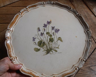 A round French vintage tray decorated with violets